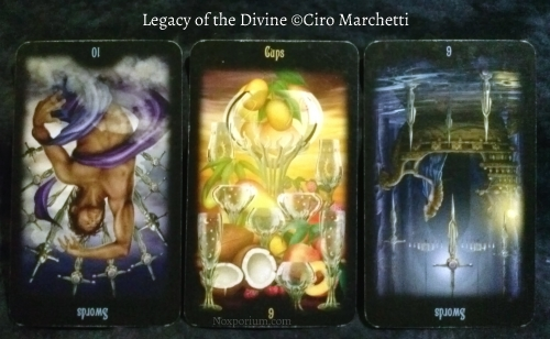 Legacy of the Divine: 10 of Swords reversed, 9 of Cups, & 6 of Swords reversed.