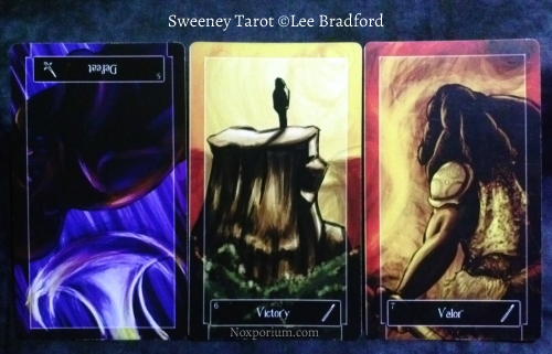 Sweeney Tarot: 5 of Swords reversed, 6 of Wands, & 7 of Wands.