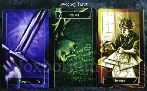 Sweeney Tarot: Ace of Swords, Knight of Cups reversed, & Ace of Wands.