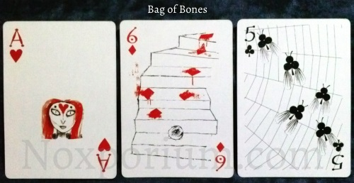 Bag of Bones: Ace of Hearts, 6 of Diamonds, & 5 of Clubs.