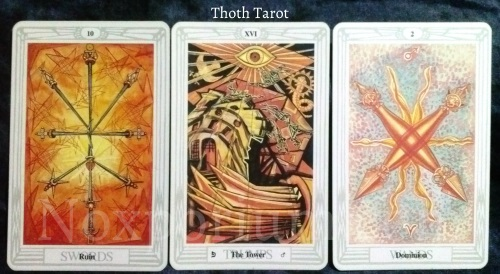 Thoth Tarot: 10 of Swords, The Tower, & 2 of Wands.