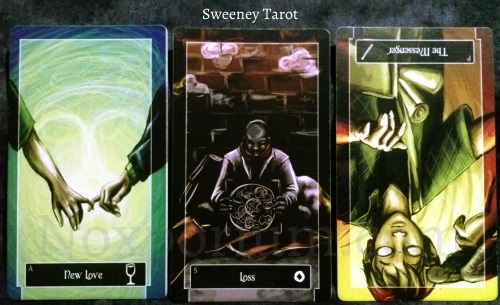 Sweeney Tarot: Ace of Cups, 5 of Coins, & Page of Wands reversed.