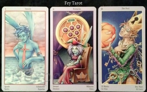 Fey Tarot: 3 of Swords, 9 of Pentacles, & The Fool.