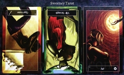 Sweeney Tarot: 10 of Wands reversed, Strength reversed, & 6 of Coins.