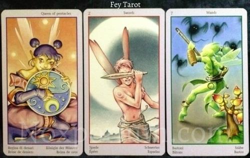 Fey Tarot: Queen of Pentacles, 2 of Swords, & 7 of Wands.