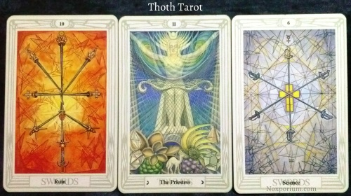 Thoth Tarot: 10 of Swords, The Priestess, & 6 of Swords.