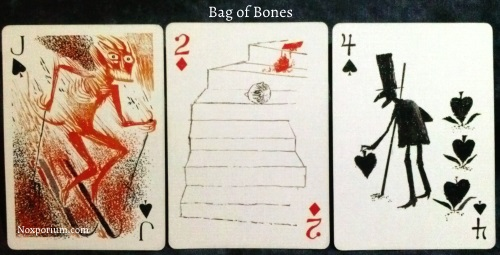 Bag of Bones: Jack of Spades, 2 of Diamonds, & 4 of Spades.