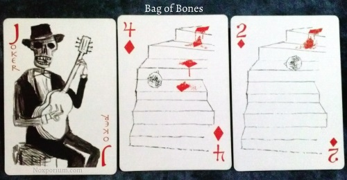Bag of Bones: Joker, 4 of Diamonds, & 2 of Diamonds.