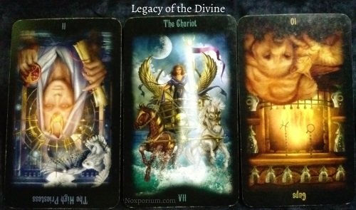 Legacy of the Divine: The High Priestess reversed, The Chariot, & 10 of Cups reversed.