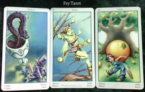 Fey Tarot: 7 of Chalices, 8 of Wands, & 10 of Wands.