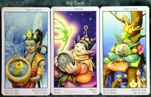 Fey Tarot: Knave of Chalices, 2 of Pentacles, & King of Wands.