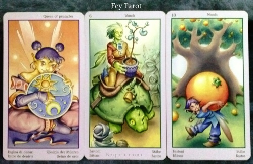 Fey Tarot: Queen of Pentacles, 6 of Wands, & 10 of Wands.