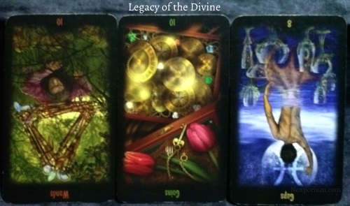 Legacy of the Divine: 10 of Wands reversed, 10 of Coins reversed, & 8 of Cups reversed.
