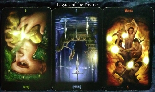 Legacy of the Divine: 4 of Coins reversed, 6 of Swords reversed, & 5 of Wands.