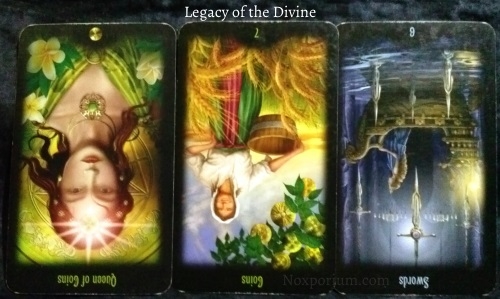 Legacy of the Divine: Queen of Coins reversed, 7 of Coins reversed, & 6 of Swords reversed.