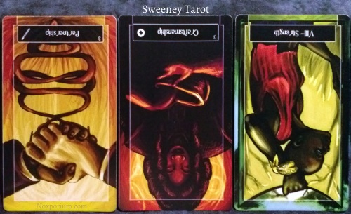 Sweeney Tarot: 3 of Wands reversed, 3 of Coins reversed, & Strength reversed.