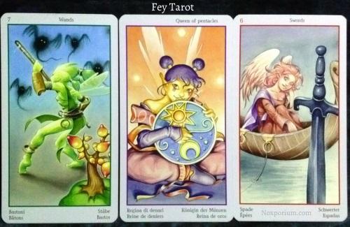 Fey Tarot: 7 of Wands, Queen of Pentacles, & 6 of Swords.