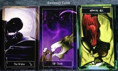 The Sweeney Tarot: Queen of Swords, Death, & Strength reversed.