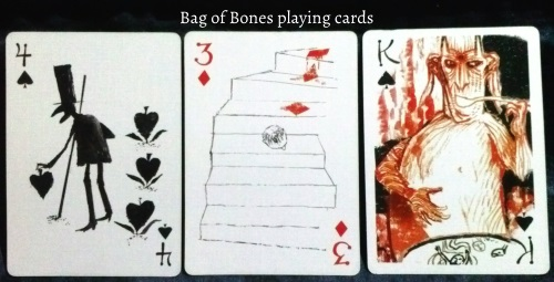 The Bag of Bones: 4 of Spades, 3 of Diamonds, & King of Spades.