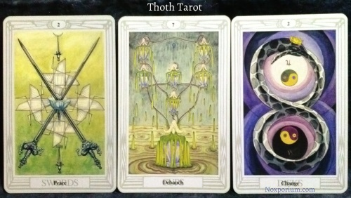Thoth Tarot: 2 of Swords, 7 of Cups, & 2 of Disks.