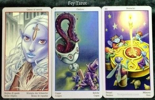 Fey Tarot: Queen of Swords, 7 of Chalices, & 10 of Pentacles.