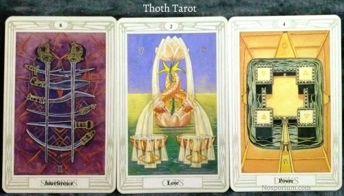Thoth Tarot: 8 of Swords, 2 of Cups, & 4 of Disks.