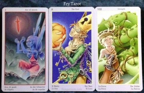 Fey Tarot: Ace of Swords, The Fool, & Strength.