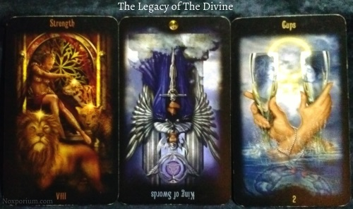 Legacy of the Divine: Strength, King of Swords reversed, & 2 of Cups.