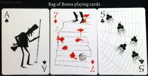 Bag of Bones: Ace of Spades, 7 of Diamonds, & 5 of Clubs.