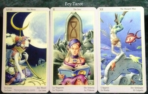 Fey Tarot: The Moon, The Seer [II], & The Hanged Man.