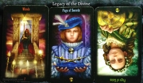 Legacy of the Divine: 7 of Wands, Page of Swords, & Page of Coins reversed.