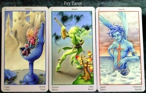 Fey Tarot: 5 of Chalices, 7 of Wands, & 3 of Swords.