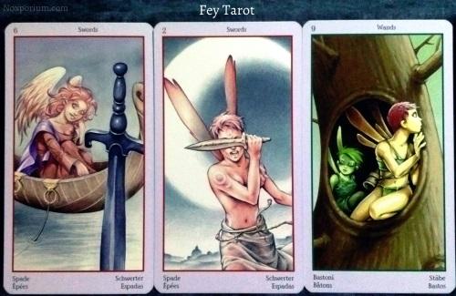 Fey Tarot: 6 of Swords, 2 of Swords, & 9 of Wands.