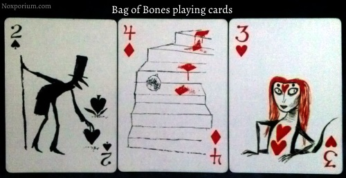 Bag of Bones: 2 of Spades, 4 of Diamonds, & 3 of Hearts.