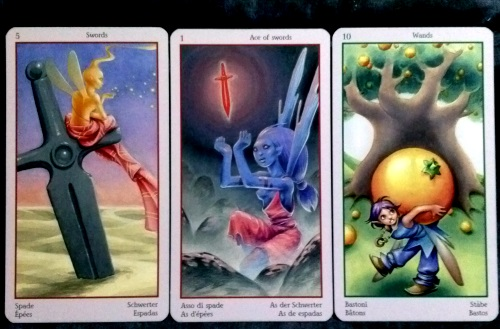 Fey Tarot: 5 of Swords, Ace of Swords, & 10 of Wands.