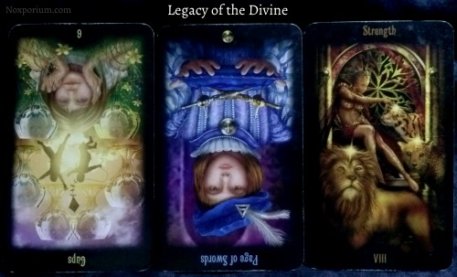 Legacy of the Divine: 6 of Cups reversed, Page of Swords reversed, & Strength.