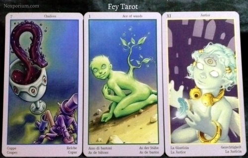 Fey Tarot: 7 of Chalices, Ace of Wands, & Justice.