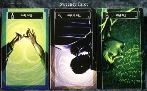 Sweeney Tarot: Ace of Cups reversed, Queen of Swords reversed, & Knight of Cups reversed.