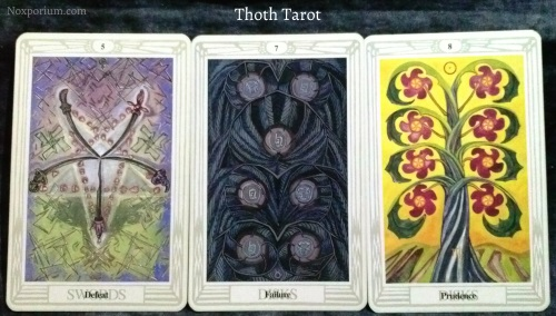Thoth Tarot: 5 of Swords, 7 of Disks, & 8 of Disks.
