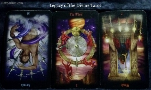 Legacy of the Divine: 10 of Swords reversed, The Wheel, & 7 of Wands reversed.