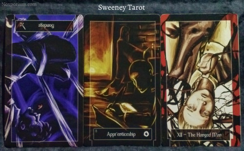 Sweeney Tarot: 8 of Swords reversed, 8 of Coins, & The Hanged Man.