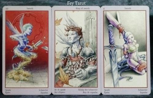 Fey Tarot: 10 of Swords, King of Swords, & 8 of Swords.