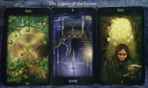 The Legacy of the Divine: Ace of Coins, 6 of Swords reversed, & 5 of Coins.