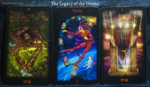 The Legacy of the Divine: 10 of Wands reversed, The Fool, & 7 of Wands reversed.