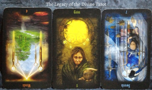 The Legacy of the Divine: 4 of Wands reversed, 5 of Coins, & 7 of Swords reversed.