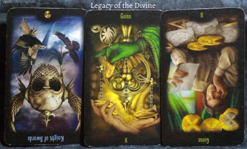The Legacy of the Divine: Knight of Swords reversed, 6 of Coins, & 8 of Coins reversed.