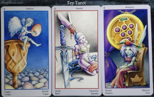 The Fey Tarot: 6 of Chalices, 8 of Swords, & 9 of Pentacles.