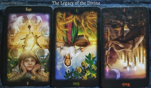 The Legacy of the Divine: 6 of Cups, 7 of Coins reversed, & 9 of Wands reversed.