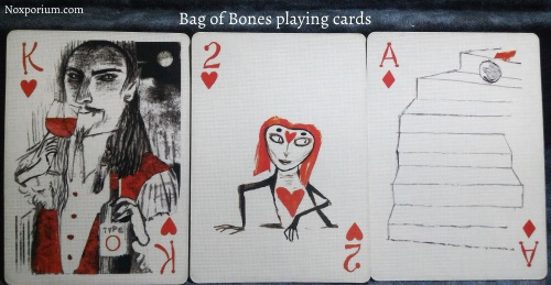 Bag of Bones: King of Hearts, 2 of Hearts, & Ace of Diamonds.