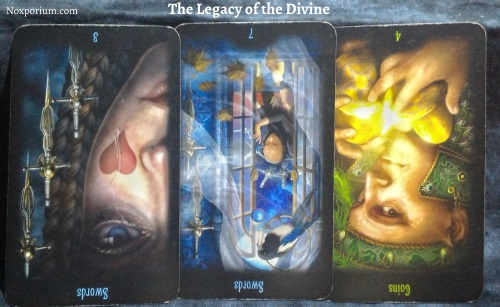 The Legacy of the Divine: 3 of Swords reversed, 7 of Swords reversed, & 4 of Coins reversed.